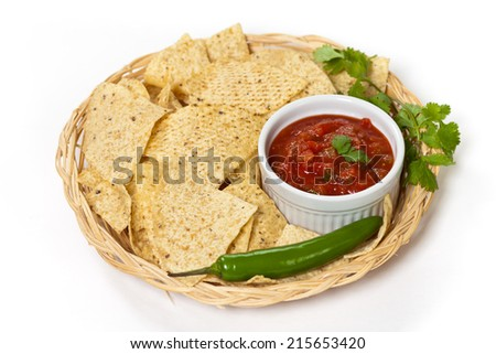 Spicy Red Salsa with tortilla chips. Selective focus. - stock photo