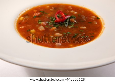 Spicy red Soup with peppers and beans
