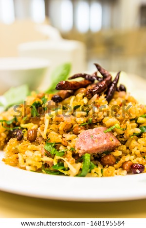 Spicy Salad of Curried Rice Croquettes, Fermented Pork, Ginger and Peanuts ,Yam Naem Khao Thot Thai name - stock photo