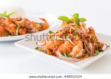 spicy salad with fried chicken on the table