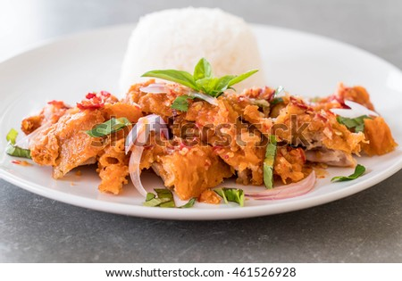 spicy salad with fried chicken with rice