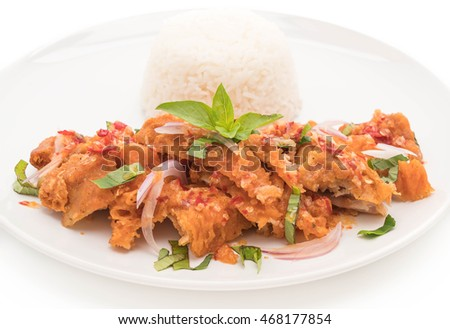 spicy salad with fried chicken with rice on white background