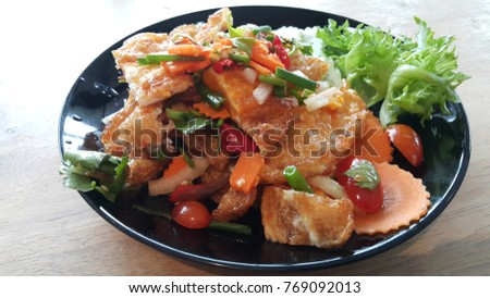 Spicy salad with fried eggs , very delicious