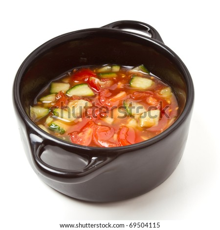 Spicy Salsa in small black cast Iron serving pot. - stock photo