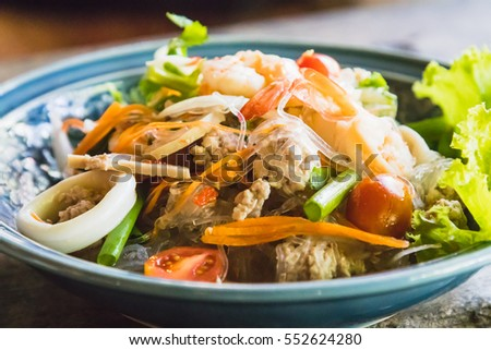 spicy seafood salad with minced pork and vegetable