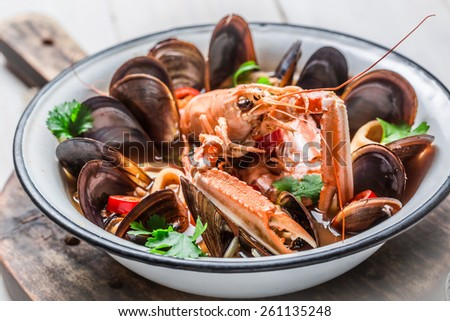 Spicy seafood soup with shrimps and mussels - stock photo