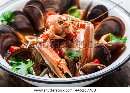 Spicy seafood soup with shrimps and mussels
