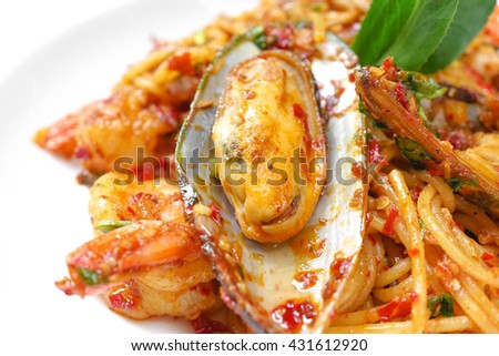 Spicy Seafood Spaghetti, Fusion Food, Selective focus, Isolated on a white dish - stock photo