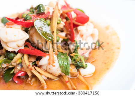 Spicy seafood stir fried, Thai spicy herb food - stock photo
