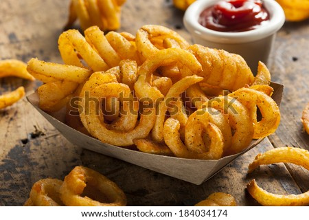 Spicy Seasoned Curly Fries Ready to Eat - stock photo