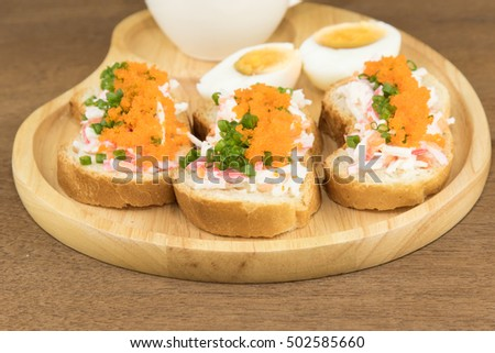 Spicy Shrimp eggs Baguette in wooden plate served with drink
