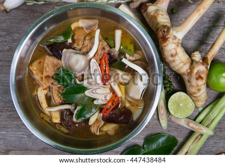 spicy soup traditional food cuisine in Thailand on wooden background (Vegetarian for good health ) - stock photo