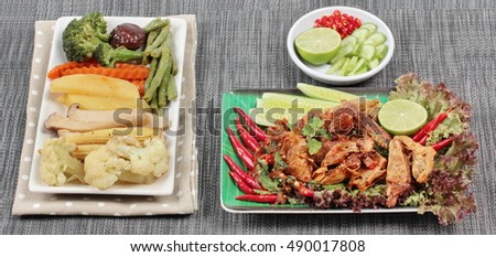 "Spicy sour mixed herb salad with fried stir taro in tofu sheet served with fried  mixed vegetables for  in Vegetable festival of Chinese as ""J food festival"" and side dish."
