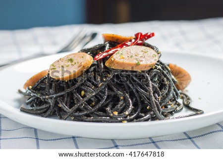 Spicy squid ink spaghetti with sausage.