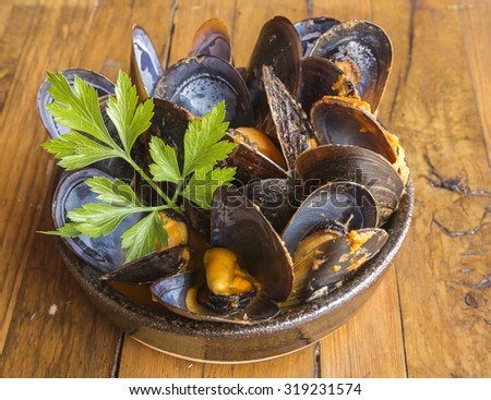 Spicy steamed mussels - stock photo