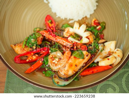 Spicy Stir Fried Seafood and white cooked rice dish  - stock photo