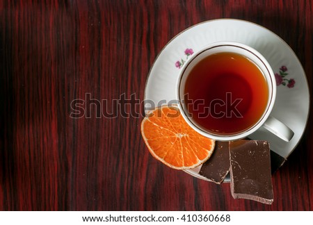 spicy tea with orange and chocolate - stock photo