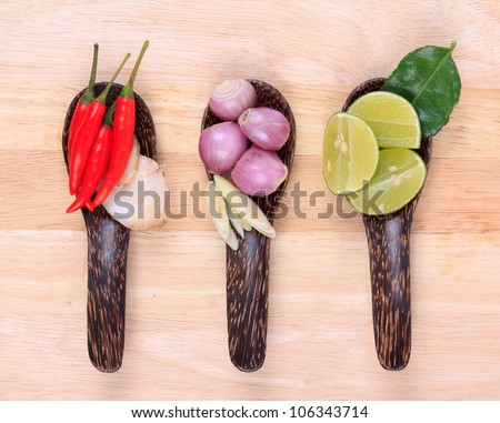 Spicy Thai food ingredients chili, lime,ginger,red onion,lemongrass on wooden background - stock photo