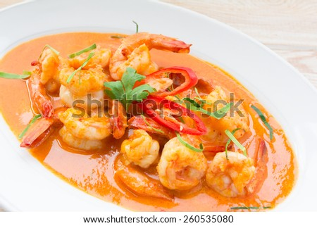 Spicy Thai food, red curry with shrimp  - stock photo