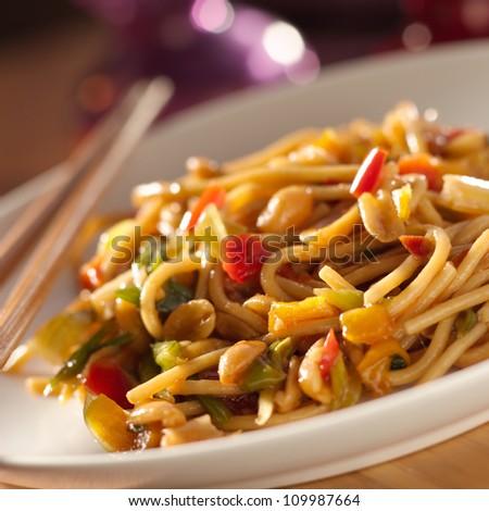 spicy thai noodles with chopsticks shot closeup - stock photo