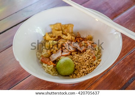 Spicy TOM YAM noodle  with Barbecued red pork served dry
