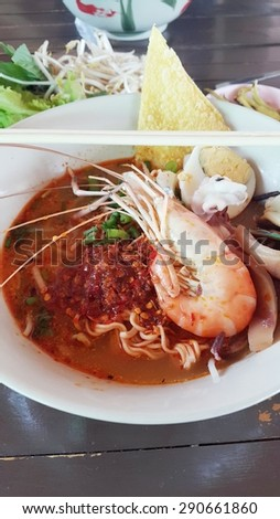 Spicy TOM YUM seafood noodle soup with lemongrass, chilli paste and lime juice