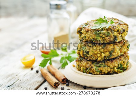 spicy vegan curry burgers with millet, chickpeas and herbs. the toning. selective focus - stock photo