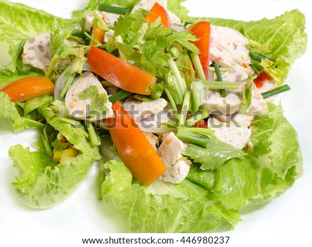 Spicy Vietnamese sausage salad or Yum Moo Yor  on white background, Thai food