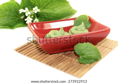 spicy Wasabi with leaf and flower in a red bowl