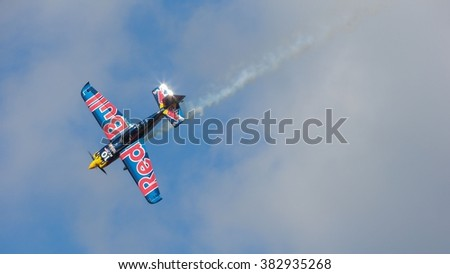 SPIELBERG, AUSTRIA - OCTOBER 26, 2014: Kirby Chambliss (USA) competes in the Red Bull Air Race. - stock photo