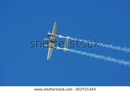 SPIELBERG, AUSTRIA - OCTOBER 26, 2014: Lockheed P-38 Lightning flys in a flight display during the Red Bull Air Race. - stock photo