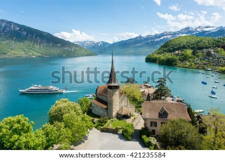 Spiez castle with cruise ship on lake Thun in Bern, Switzerland. - stock photo