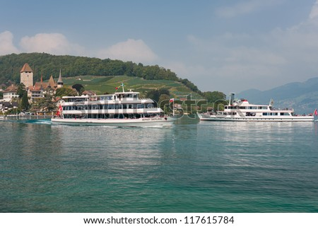SPIEZ, SWITZERLAND - SEPTEMBER 6: Two passenger ships at the berth on September 7, 2012 in Spiez. Since 1835 passenger ships have operated on Thun lake, the voyages became very popular among tourists
