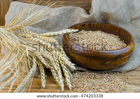 Spikes of wheat and refined grains.