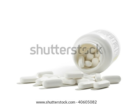 Spilled bottle of tablets - stock photo