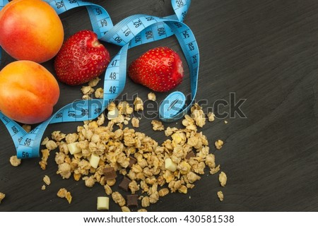 Spilled Cheerios cereal with chocolate. Healthy dietary supplements for athletes. Cheerios for breakfast. Muesli and fruit. The diet for weight loss. Muesli to eat. Sweet muesli.  - stock photo