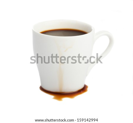 spilled coffee from a cup isolated on white - stock photo