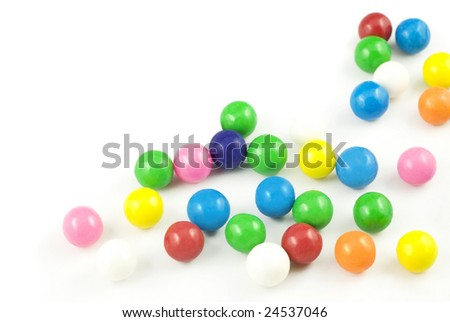 Spilled colored gumballs, on a horizontal white background with copy space - stock photo