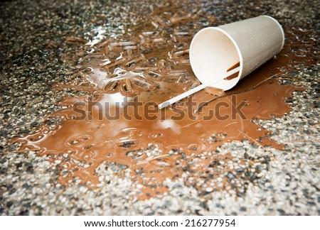 spilled ice coffee on Floor - stock photo