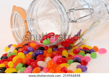 Spilled Jar of jelly beans - stock photo