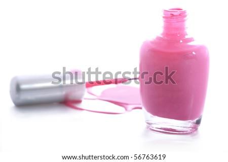 Spilled pink nail polish - stock photo