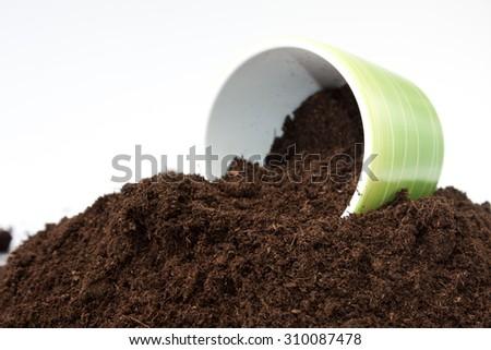 Spilled soil from flowerpot on the pile of soil. - stock photo
