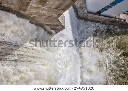 Spillway on hydroelectric power station dam in Russia - stock photo