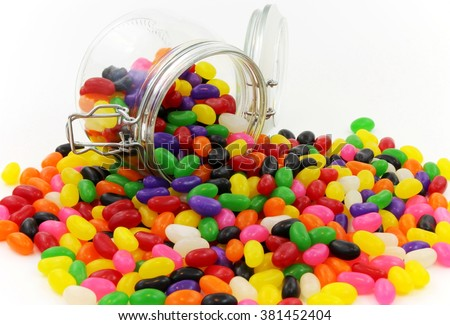 Spilt Jelly Beans from Glass Jar with Lid - stock photo