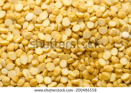 Spilt yellow peas - stock photo