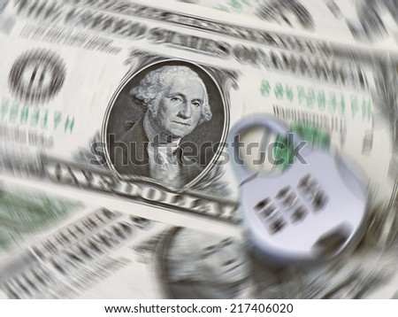 Spin effect added to closeup of US dollar bills with padlock