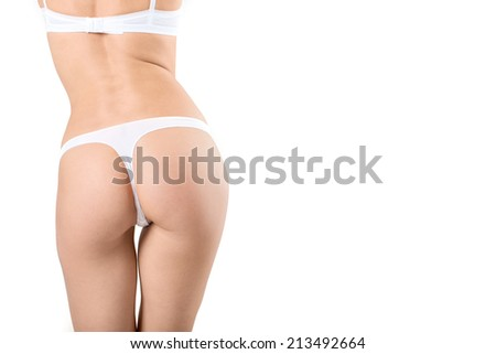 Spin the girl on a white background in the lingerie - stock photo