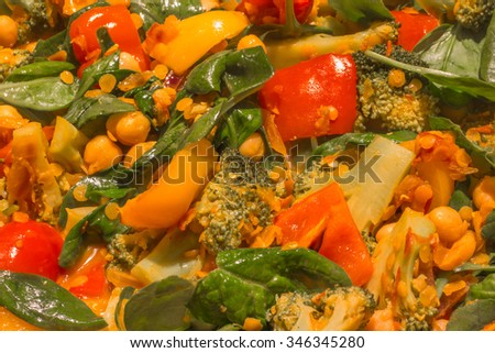 spinach and chickpea curry with red and yellow peppers - stock photo