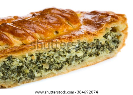 Spinach and feta cheese pie. Close up view of a piece isolated on white background - stock photo