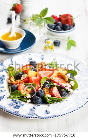 Spinach and Fruit Salad with Honey Mustard Vinaigrette - stock photo
